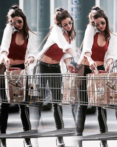 Danielle campbell | grocery shopping | long sleeve white cardigan + red crop top + black skinny jeans + high, heeled boots + hair half back bun