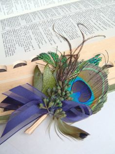 Peacock boutonniere for rustic vintage