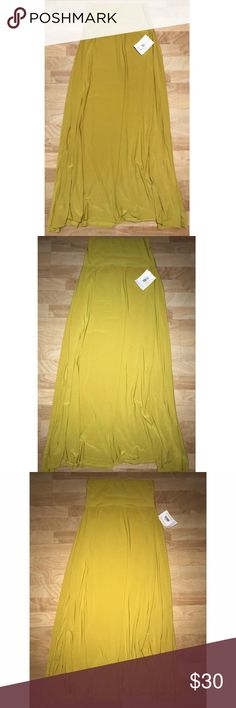 NWT LulaRoe Mustard Maxi Skirt Super cool color. Yellow but a unique yellow that I'm not sure how to describe(I'm bad with colors 😭).. silky/slinky material. Perfect for summer and looks amazing with a pretty white top and some cute sandals. 🌸PRICE FIRM🌸 LuLaRoe Skirts Maxi