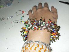 Make a safety pin bracelet.