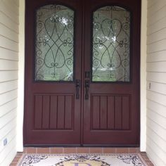 Rustic Fiberglass doors with Wrought Iron Glass installed in SteepleChase Farms @ Delatorre residence