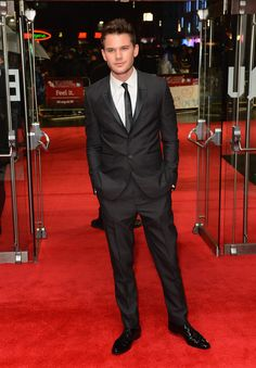 British actor Jeremy Irvine wearing Burberry tailoring to the premiere of 'Great Expectations' in London last night