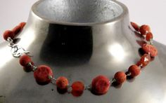 Necklace with foam coral, carnelian and small fac. chrysophras on fine silver.