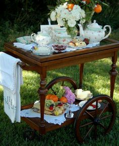 """One of our favorite recent finds was a wooden tea cart, and looky here! What a great idea for an outdoor event. Check out our tea cart in """"Our Furniture Finds"""""""