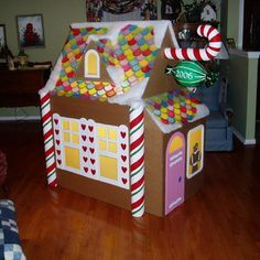 DIY Giant Cardboard Gingerbread House! lights up! Haha too cute!! Looks like it would b a lot of work, would b fun for fam to do it together:)