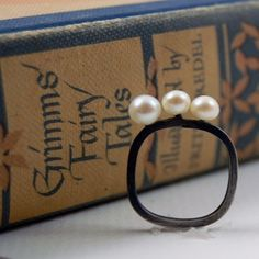 Oxidized Silver Ring with 3 white pearls by Markhed by MarKhed, $105.00  I like the way that the pearls seem to float along the top of the band
