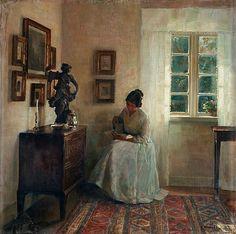 Carl Holsoe Danmark 1863-1935 Interiör med läsande kvinna.