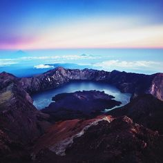Sunrise at the summit of Gunung Rinjani in Lombok Indonesia. Small cameo by Bali and Gili islands in the distance