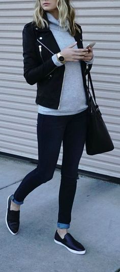 black jacket and bag, grey sweater and jeans outfit