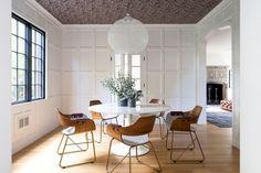 White paint on trim, wallpaper on celling     Tour a Modernized Tudor in Newton, Massachusetts via @mydomaine
