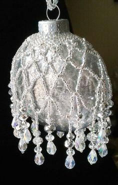 Clear Flat Bulb, Mirror Spray and Vinager antiques the bulb to look like Mercury Glass.  Some netting and add a few crystals.  By Sharon A. Kyser