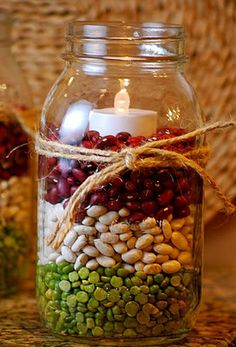 Beans as mason jar filler... battery operated tea light, with twine or yarn wrapped around jar.