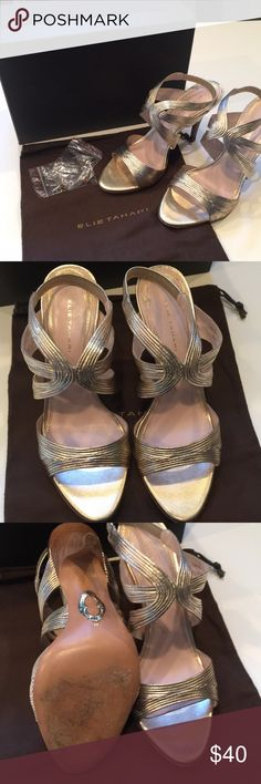 Elie Tahari Sandal Elie Tahari Gold Sandal.  100% Leather.  Almost new.  Wore once for wedding.  Size 8.5. Have original box, shoe bag and replacements for heels when needed Elie Tahari Shoes Sandals