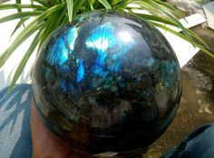 A beautiful labradorite quartz crystal sphere, bowling ball sized, weighing in at over 11 massive pounds!!!