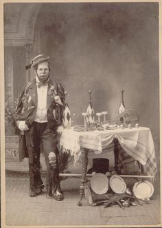 The juggler....from the state of this clowns costume I dont think his new knife juggling circus act is going very well...vintage photo