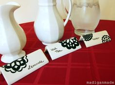 Dry erase boards made from white corner tiles - this is SO smart for labeling food at parties!