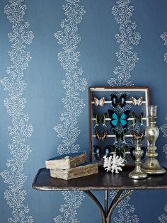 Sparkle Coral Vinyl Wallpaper behind table