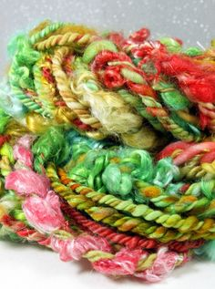 Handspun Art Yarn- SweetHeart Roses- Signature WildPlied Artisan Yarn. $68.00, via Etsy.