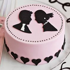 A silhouette couple by Cheryl Kleinman Cakes #cake #pinkandblack