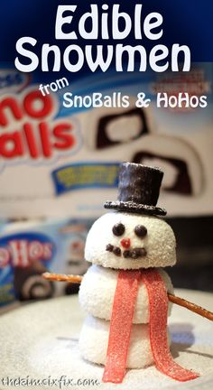 SnoBall Snowman: The hat is a HoHoHo and half a sandwich cookie, the scarf is a sour belt and the arms are pretzels.  Dust with powdered sugar as the finishing touch!  A perfect mini-centerpiece or as an individual treat on each plate. #HostessHoliday  #HostessHolidaySweeps