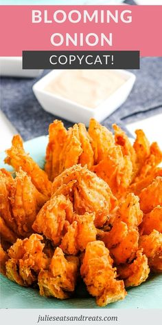 If you need an impressive appetizer recipe that everyone will love make this Blooming Onion! It has a slightly spicy breading, is deep fried until golden and is served with a delicious sauce. A copycat version of the famous Outback Steakhouse one that you can make at home whenever you want. #blooming #onion Recipes Appetizers And Snacks, Yummy Appetizers, Veggie Recipes, Cooking Recipes, Yummy Recipes, Vegetarian Appetizers, Dip Recipes, Recipies, Dinner Recipes