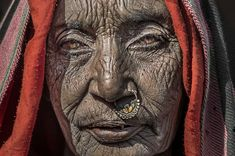 The Old Lady (Jaipur, Rajasthan, India)Elderly woman met in Jaipur (Rajasthan, India).  Jaipur is the capital and largest city of the Indian state of Rajasthan in Northern India. It was founded on 18 November 1727 by Maharaja Sawai Jai Singh II, the ruler of Amber, after whom the city is named. The city today has a population of 3.1 million.