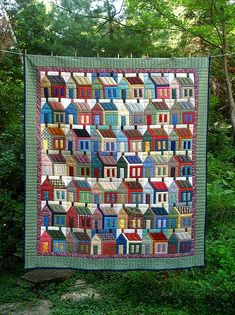 Colorful House Quilt Hanging with Trees in Background