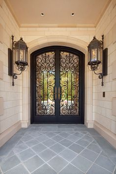 Wrought iron doors and natural gas lanterns