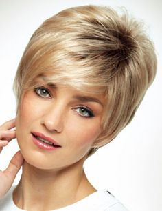 Marni Wig by Revlon is a short and edgy cut with a polished appearance. This short cut has textured layers and angled bangs.