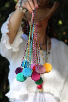 Pom Pom Swag ✮ Because everything in life is better with Pom Poms.  Tie one on your purse, tie back your curtains, tie one just about anywhere!  WomanShopsWorld exclusive.