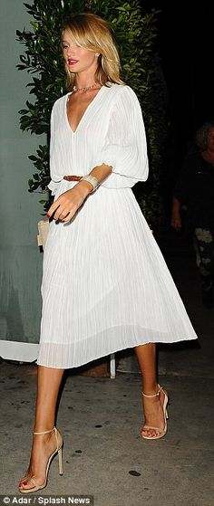 Well-heeled: She topped off the look with a pair of nude strappy sandals and a patterned clutch