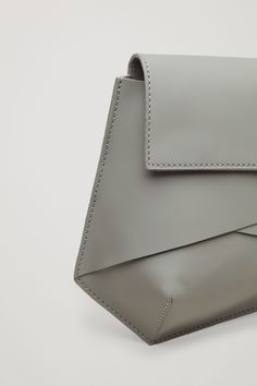 COS image 3 of Folded rubberised leather bag in Dark Sage