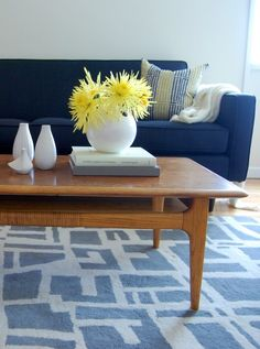 Love this blue sofa creating the room's color theme.  Also loving the coffee table.