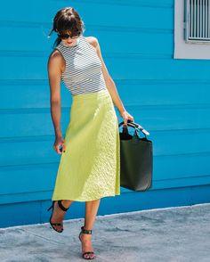 We're loving midi skirts this Summer- www.letote.com