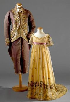 Men's costume of purple silk and young girl's dress of white silk with a yellow overlay circa 1810. Museu Nacional do Traje.