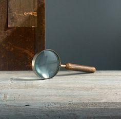 Antique German magnifying glass. Wooden handle. Vintage optical desk glass lens.