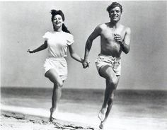 """Ava and Burt Lancaster had some fun on a beach photo shoot for """"The Killers""""! What a pair! #NationalRunningDay"""