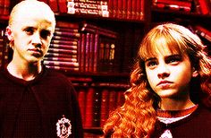 Dramione♡ When he looks from his dad to her it looks like his smirk turns into a slight smile.