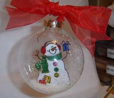 Glass ball Ornaments This is a great idea! Imagine transfering kids drawings for grandparents :)