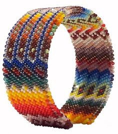 """Lakota Sioux Beaded """"Peyote Stitch"""" Bracelet: Small -  Michael sews his beads around a piece of flexable metal. There is just enough give to make it possible to put the bracelet on without forcing it on and the same goes for taking it off."""