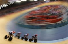 Britain's Ed Clancy, Geraint Thomas, Steven Burke and Peter Kennaugh compete in the track cycling men's team pursuit first round heats at the Velodrome during the London 2012 Olympic Games August 3, 2012. REUTERS-Stefano Rellandini