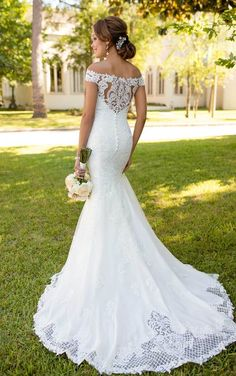 Boho lace and off-the-shoulder sleeves make a statement in this designer wedding dress by Stella York. Lace and tulle over matte-side Lustre satin create a swee