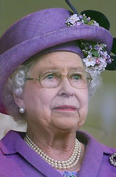 Queen Elizabeth tears up as she watches her filly Estimate, win the Gold Cup on Ladies Day at Royal Ascot, June 20, 2013.