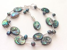Fabulous iridescent Paua shells are said to be the most beautiful shells in the world. The Maori say these shells are the treasure from the God of the Sea. In this stunning necklace the vibrant pearly colours of turquoise, greens, pinks, purples and greys are seen in each double sided