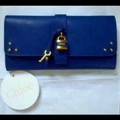 NWT Chloe Portefeuille Aurore Clurch - RARE! Brand new with tags, care booklet, authenticity card with hologram and dust bag. Never used. Purchased for $880.00 plus tax & shipping last year. 1 of only 50 made in this Royal Navy color. Functional lock & key. Trade value HIGHER. Chloe Bags Clutches & Wristlets
