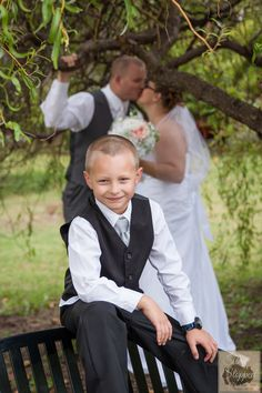 Weddings. Hampton Roads Weddings. Virginia Weddings. Grooms little man,  Brides little man, Wedding Photography,  Time Stopped Photography, the kiss
