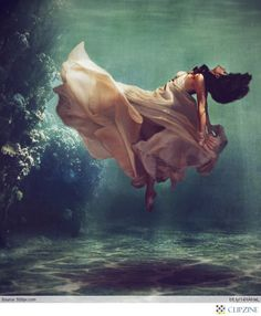 could be created with careful exposure adjusting on dress to create feeling of beams of light underwater