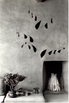Myron Wood (1921-1999): Mobile by Alexander Calder  Georgia O'Keeffe's house in Abiquiu, New Mexico, 1980 (via)