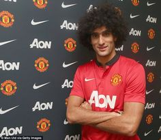 Fellaini poses in a Manchester United shirt