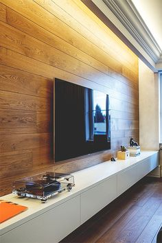 TV wall with recessed lighting.